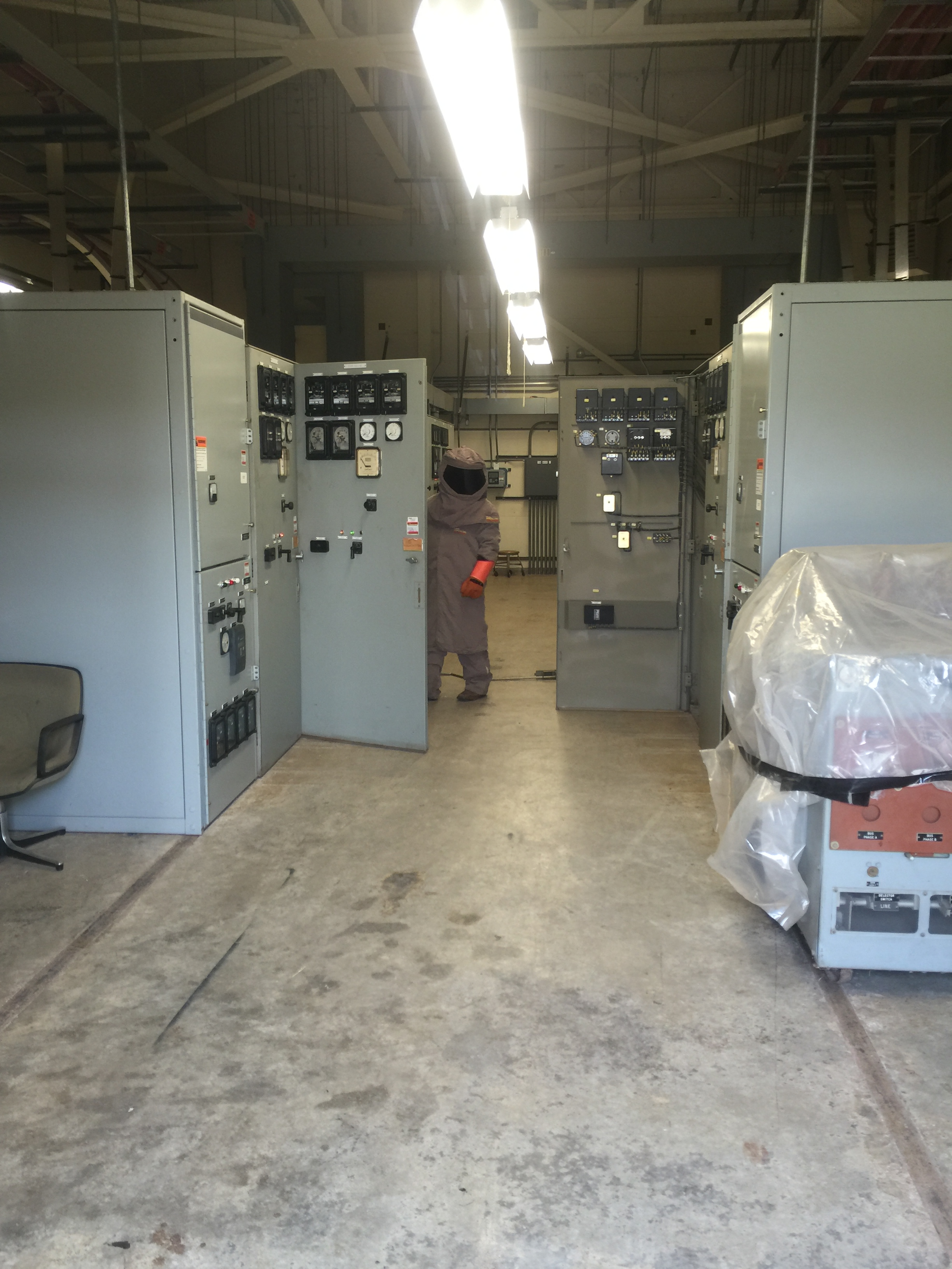 Utilization of Arc Flash Protective Equipment to connect a 480 volt Main Circuit Breaker to Energized Switchgear in a Sub-Station at one of the many Industrial Facilities we provide service to.