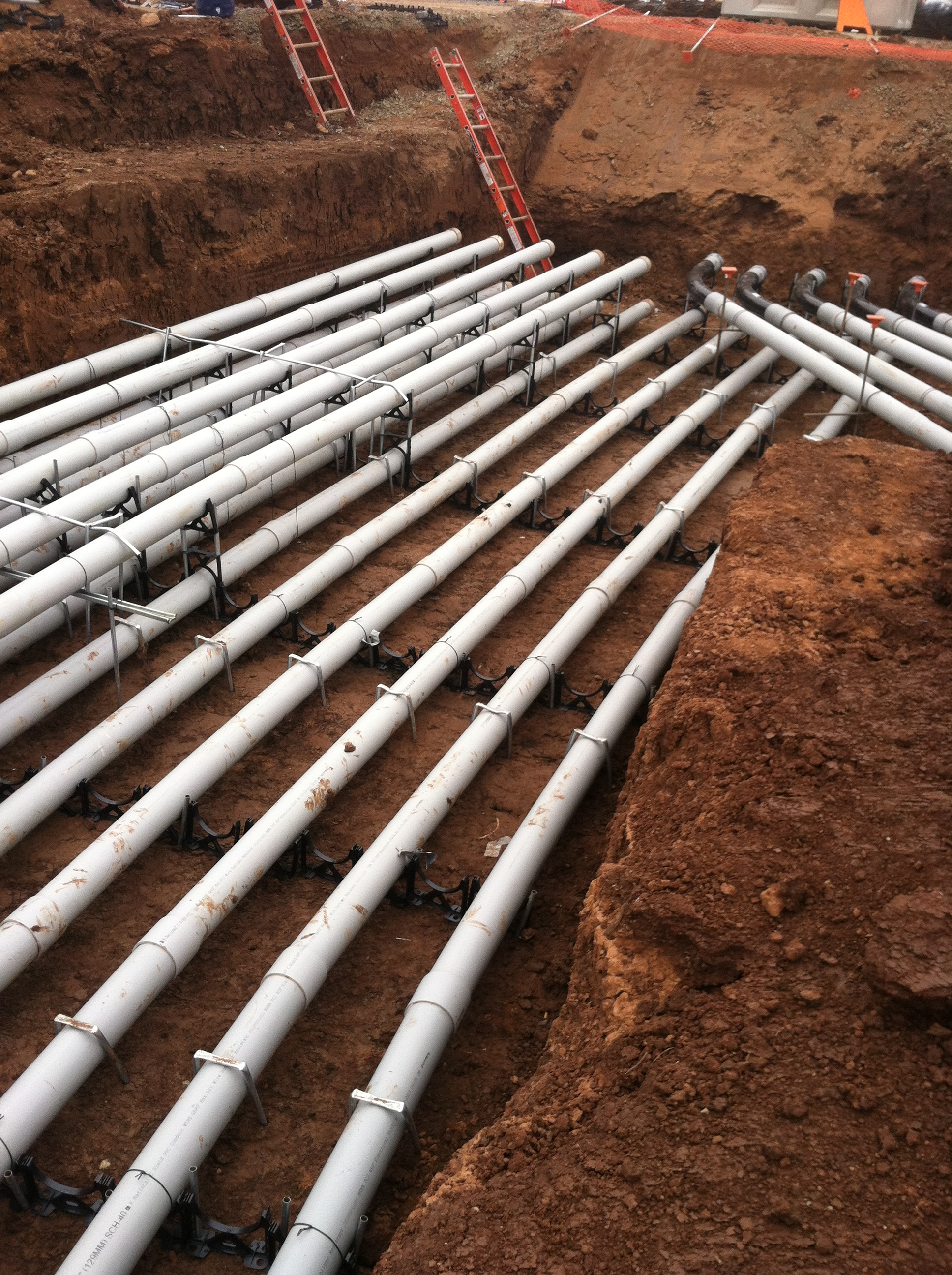 Installation of Concrete Encased Primary and Secondary Voltage Service Conduits.